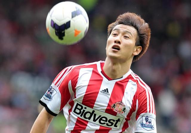 Ji Dong-Won heads the ball for Sunderland in a Premier League game against Fulham at the Stadium of Light, Sunderland, northeast England, on August 17, 2013