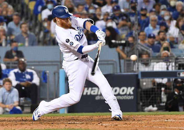 Los Angeles Dodgers' Justin Turner hits a solo home run to tie the game