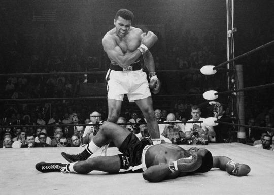 <p>Heavyweight champion Muhammad Ali stands over fallen challenger Sonny Liston, shouting and gesturing shortly after dropping Liston with a short hard right to the jaw on May 25, 1965, in Lewiston, Maine. The bout lasted only one minute into the first round. Ali is the only man ever to win the world heavyweight boxing championship three times. He also won a gold medal in the light-heavyweight division at the 1960 Summer Olympic Games in Rome as a member of the U.S. Olympic boxing team. In 1964 he dropped the name Cassius Clay and adopted the Muslim name Muhammad Ali. (AP Photo/John Rooney)</p>