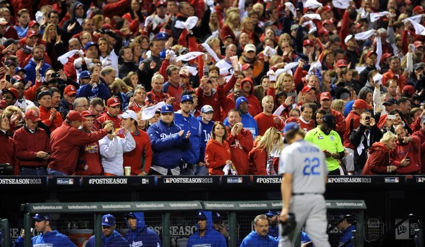 Dodgers pitcher Clayton Kershaw comes out of the game against the Cardinals in game 6 of the NLCS