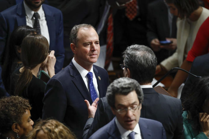 Rep. Adam Schiff, D-Calif., Chairman of the House Intelligence Committee speaks with members on the floor during a vote on the articles of impeachment against President Donald Trump, Wednesday, Dec. 18, 2019, on Capitol Hill in Washington. (AP Photo/Patrick Semansky)