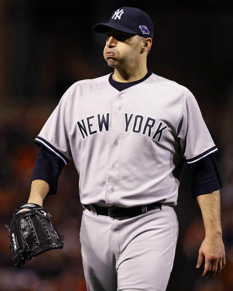 New York Yankees starting pitcher Andy Pettitte reacts as he walks off the field at the end of the fourth inning of Game 2 of the American League division baseball series against the Baltimore Orioles, Monday, Oct. 8, 2012, in Baltimore. The Orioles won 3-2. (AP Photo/Alex Brandon)