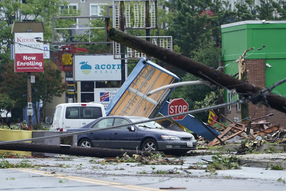 Debris is strewn along West Street in Annapolis, Md., Wednesday, Sept. 1, 2021, after severe weather moved through the area. (AP Photo/Susan Walsh)