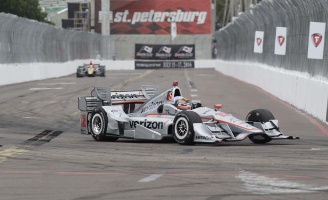 FILE - In this March 13, 2016, file photo, Oriol Servia, of Spain, drives the car of Will Power, of Australia, into Turn 10 during the IndyCar Firestone Grand Prix of St. Petersburg auto race in St. Petersburg, Fla. IndyCar plans to crown its champion on the streets of St. Petersburg, Florida, as the original opener has been rescheduled to Oct. 25 as the finale. (AP Photo/Luis M. Alvarez, File)