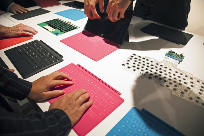 Microsoft Corp.'s Surface tablet computers, aiming to compete with Apple's iPad, are displayed at Hollywood's Milk Studios in Los Angeles Monday, June 18, 2012. The 9.3-millimeter thick tablet comes with a kickstand to hold it upright and keyboard that is part of the device's cover. (AP Photo/Damian Dovarganes)