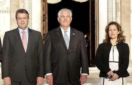 German Foreign Minister Sigmar Gabriel, U.S. Secretary of State Rex Tillerson and Canada's Foreign Affairs Minister Chrystia Freeland, pose for a family photo during a G7 for foreign ministers in Lucca