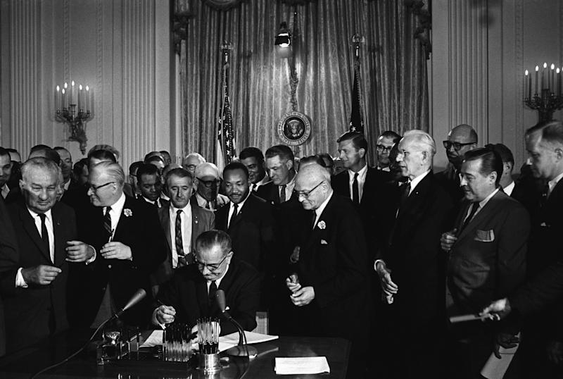 Then-President Lyndon B. Johnson signs the 1964 Civil Rights Act, whichestablished a Justice Department office to provide confidential services to ease tensions in communities facing racial and other conflicts. The Trump administration's budget proposal would eliminate the office.