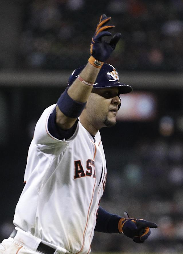 Houston Astros' Carlos Corporan waves as he hits a home run to left field during the fourth inning of a baseball game against the Arizona Diamondbacks, Thursday, June 12, 2014, in Houston. Robbie Grossman also scored. (AP Photo/Patric Schneider)