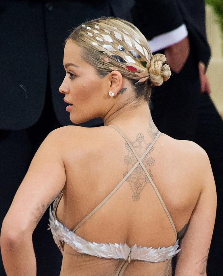 "<p>The singer took <a rel=""nofollow"" href=""http://www.glamour.com/story/this-10-second-kylie-jenner-ha?mbid=synd_yahoobeauty"">hair tattoos</a> to the next level with this mirrored look at the 2016 Met Gala.</p>"