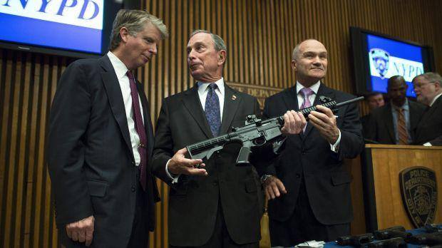 This photo from Friday, Oct. 12, 2012, shows District Attorney Cyrus Vance, left, Mayor Michael Bloomberg, center, NYPD Police Commissioner Ray Kelly, right, with confiscated illegal firearm during a press conference in New York.