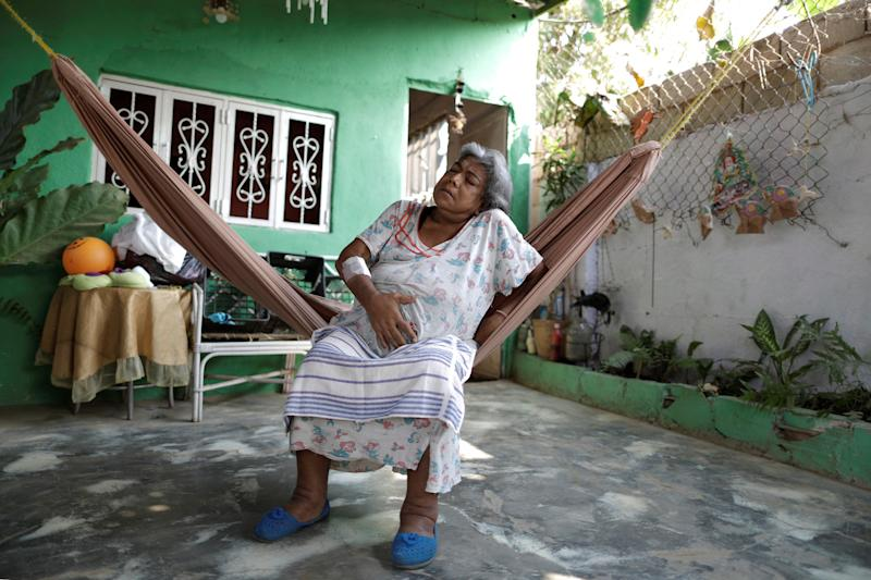 Lesbia Avila de Molina, 53, a kidney disease patient, holds her stomach, due to pain, in her house during a blackout in Maracaibo, Venezuela. (Photo: Ueslei Marcelino/Reuters)