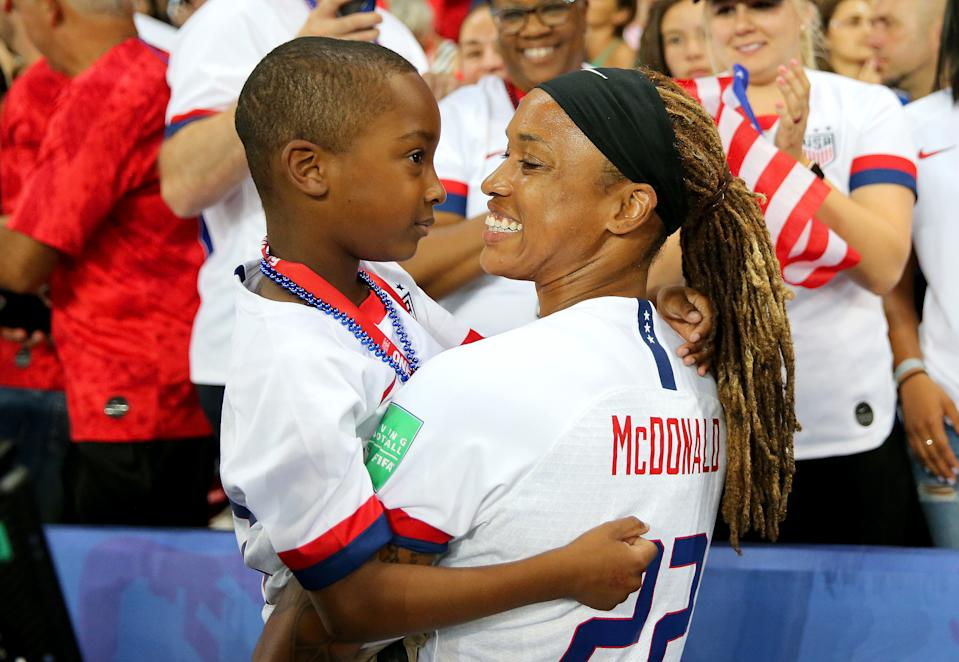 PARIS, FRANCE - JUNE 28:  Jessica McDonald of the USA celebrates with her son following the 2019 FIFA Women's World Cup France Quarter Final match between France and USA at Parc des Princes on June 28, 2019 in Paris, France. (Photo by Maddie Meyer - FIFA/FIFA via Getty Images)