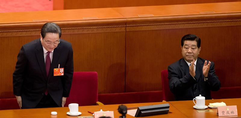Yu Zhengsheng, left, bows after being announced as a new chairman of the Chinese People's Political Consultative Conference (CPPCC), as the outgoing Chairman Jia Qingling applauds during a plenary session of the CPPCC held at the Great Hall of the People in Beijing Monday, March 11, 2013. China took another step toward completing its leadership handover Monday with the appointment of Yu best known for his communist pedigree to head the top government advisory body. (AP Photo/Andy Wong)