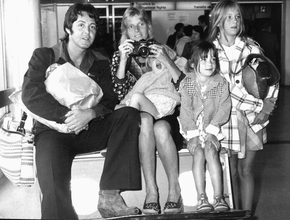 Paul and Linda McCartney with their children Stella, Mary and Heather at Heathrow Airport in London, England 1974. (Photo: Getty Images)