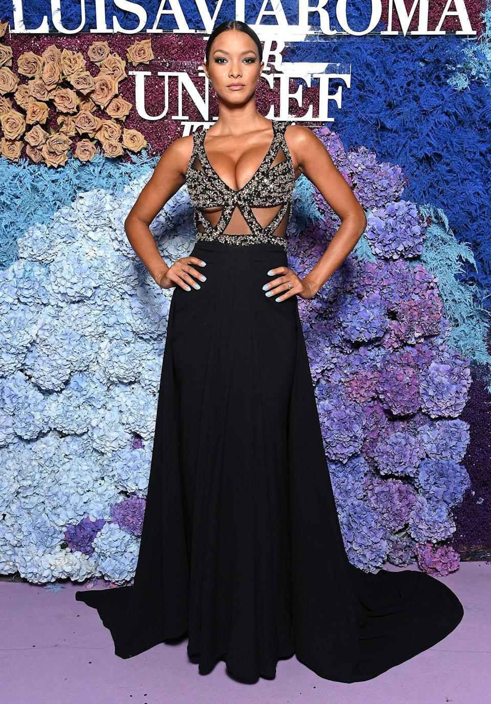 <p>in a Zuhair Murad Couture gown with embellished crisscross bodice and black flowing skirt. </p>