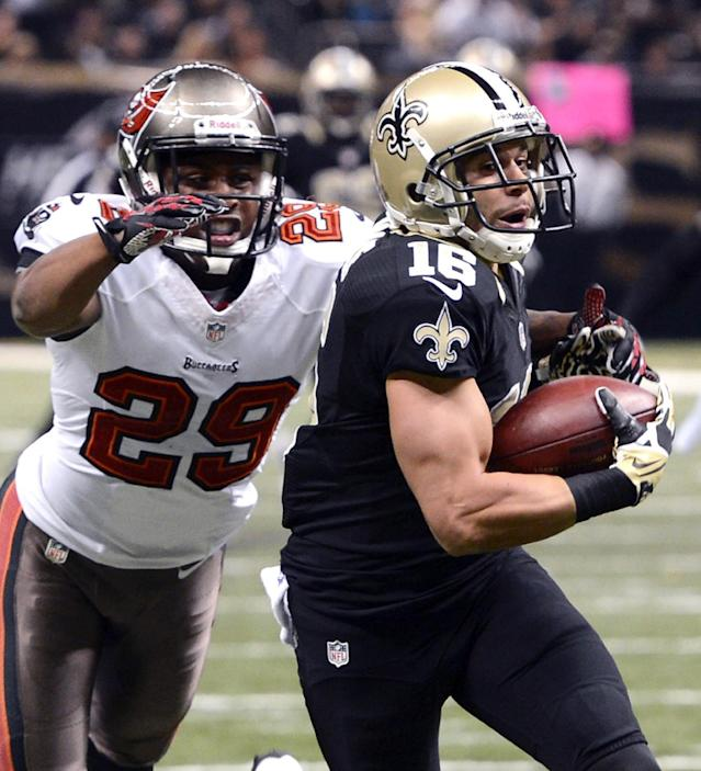 New Orleans Saints wide receiver Lance Moore (16) pulls in a touchdown reception in front of Tampa Bay Buccaneers cornerback Leonard Johnson (29) during the first half of an NFL football game, Sunday, Dec. 29, 2013, in New Orleans. (AP Photo/Bill Feig)