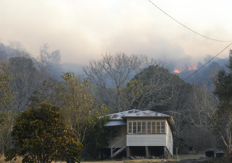 A property under threat from bushfire near the rural town of Canungra in the Scenic Rim region of South East Queensland, Friday, September 6, 2019. Residents of the Gold Coast hinterland community of Sarabah, where a fast-moving bushfire is spreading, has been told to leave and move to the Canungra Showgrounds. Source: AAP Image/Regi Varghese