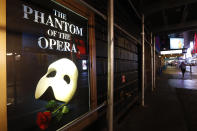 """FILE - In this March 12, 2020, file photo, a poster advertising """"The Phantom of the Opera"""" is displayed on the shuttered Majestic Theatre in New York. Broadway theatergoers will need to prove they've been vaccinated for COVID-19 and masks will be required when theaters reopen in the coming weeks, producers announced Friday, July 31, 2021. (AP Photo/Kathy Willens)"""