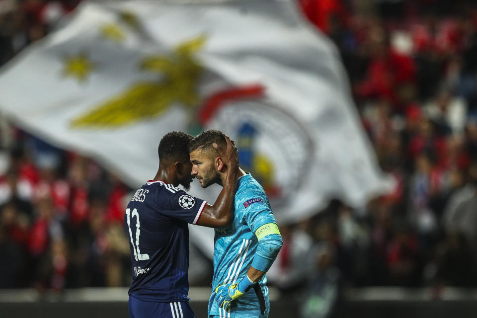 Thiago Mendes comforts goalkeeper Anthony Lopes after a terrible mistake cost Lyon against Benfica in the Champions League. (Getty)