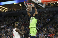 Minnesota Timberwolves' Jarrett Culver (23) puts the ball in the basket against Los Angeles Clippers' JaMychal Green in the first half of an NBA basketball game Saturday, Feb. 8, 2020, in Minneapolis. (AP Photo/Stacy Bengs)