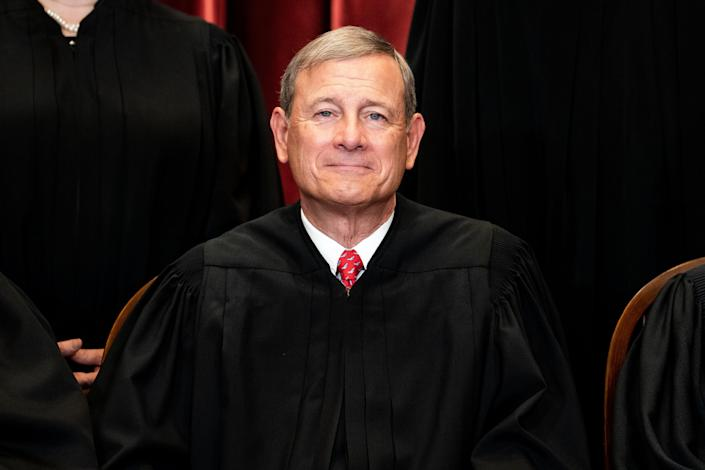 Chief Justice John Roberts sits during a group photo of the justices at the Supreme Court in Washington, D.C., on April 23, 2021.