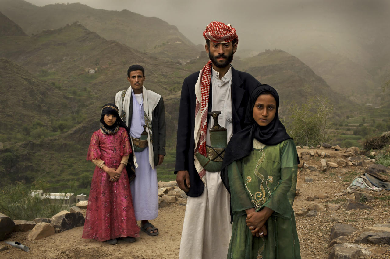 In this photo provided on Friday Feb. 10, 2012 by World Press Photo, the 1st prize Contemporary Issues Stories category of the 2012 World Press Photo contest by Stephanie Sinclair, USA, VII Photo Agency for National Geographic magazine shows Tahani (in pink), who married her husband Majed when she was 6 and he was 25, posing for this portrait with former classmate Ghada, also a child bride, outside their mountain home in Hajjah, Yemen, June 10, 2010. Nearly half of all women in Yemen were married as children. (AP Photo/Stephanie Sinclair, VII Photo Agency for National Geographic magazine)