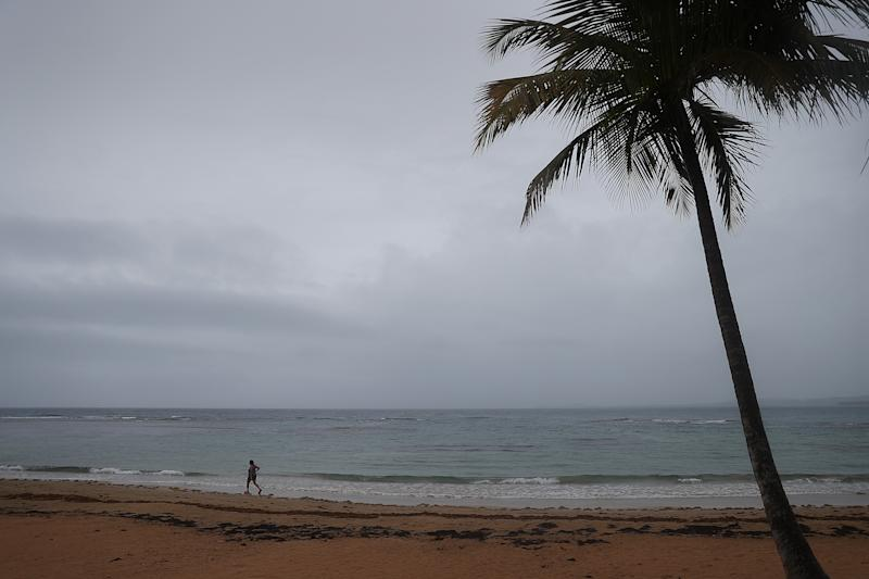 A person is seen along the beach as Tropical Storm Dorian passes the island on Aug. 28, 2019 in Luquillo, Puerto Rico. The Tropical Storm is expected to hit along the southeast coast as a possible category 2 hurricane. (Photo: Joe Raedle/Getty Images)