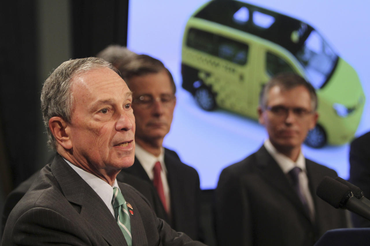 New York City Mayor Michael Bloomberg, left, is joined by Carlos Tavares, right, chairman of Nissan Motor Co.'s Americas operation, as he announces the winner of the Taxi of Tomorrow competition during a news conference at City Hall, Tuesday, May 3, 2011 in New York. The Nissan NV 200 will be the first taxicab especially built for use in New York City.