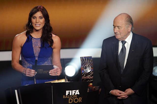 ZURICH, SWITZERLAND - JANUARY 07: (L-R) Hope Solo and Joseph Blatter, FIFA president announce Abby Wambach of United States during the FIFA womens player of the year trophy during the FIFA Ballon d'Or Gala 2013 at Congress House on January 07, 2013 in Zurich, Switzerland. (Photo by Christof Koepsel/Getty Images)
