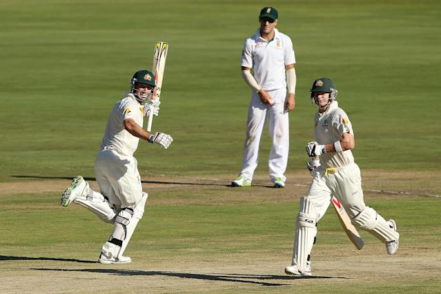 CENTURION, SOUTH AFRICA - FEBRUARY 12: Shaun Marsh (L) of Australia celebrates reaching 100 runs during day one of the First Test match between South Africa and Australia on February 12, 2014 in Centurion, South Africa. (Photo by Morne de Klerk/Getty Images)