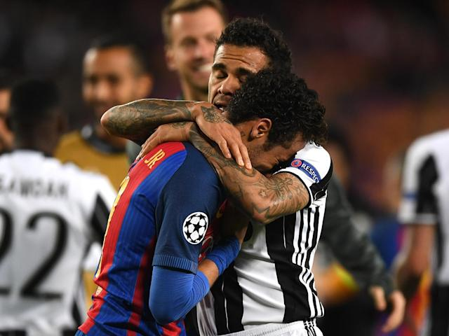 Dani Alves comforted his former team-mate Neymar after the final whistle: Getty