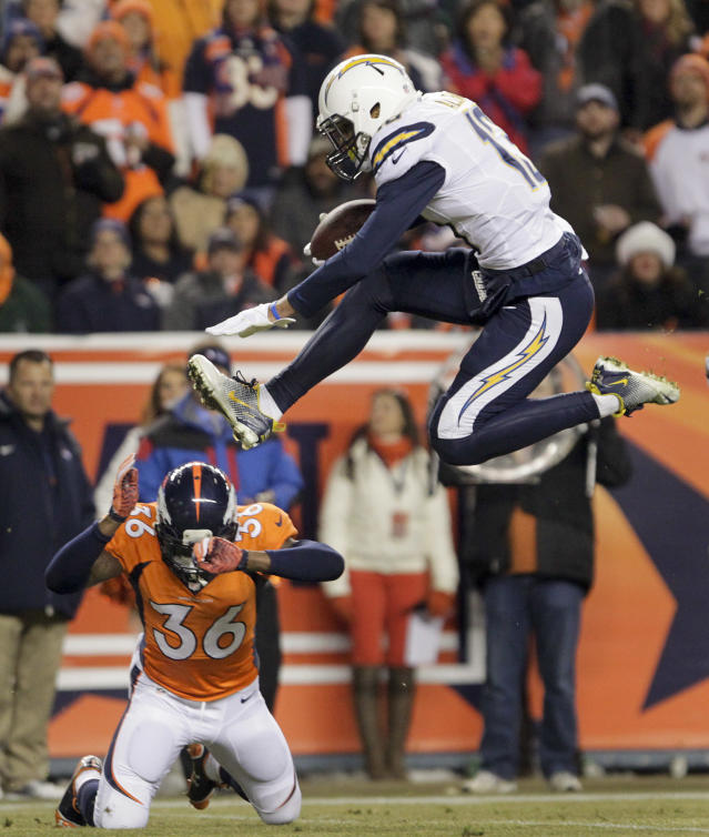 San Diego Chargers wide receiver Keenan Allen (13) leaps over Denver Broncos cornerback Kayvon Webster (36) on his way to the end zone for a touchdown in the second quarter of an NFL football game, Thursday, Dec. 12, 2013, in Denver. (AP Photo/Joe Mahoney)