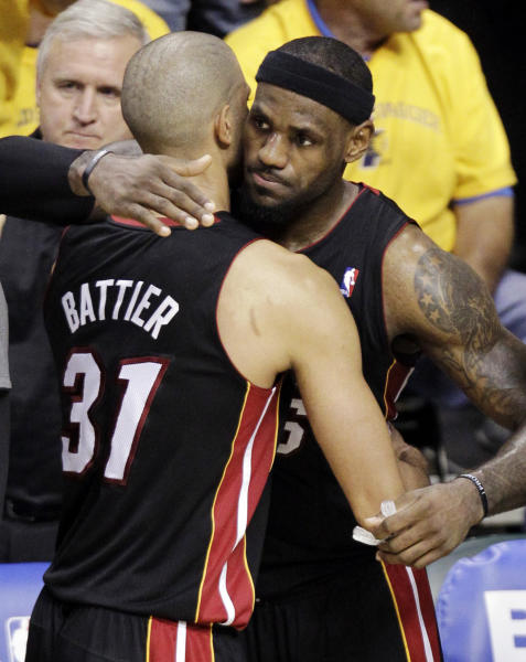 Miami Heat forward LeBron James, right, hugs Shane Battier as they leave the court late in the fourth quarter in Game 6 against the Indiana Pacers in their NBA basketball Eastern Conference semifinal playoff series in Indianapolis, Thursday, May 24, 2012. The Heat defeated the Pacers 105-93 to win the series 4-2. (AP Photo/Michael Conroy)