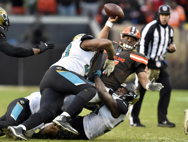<p>Cleveland Browns quarterback DeShone Kizer (7) is sacked in the second half of an NFL football game against the Jacksonville Jaguars, Sunday, Nov. 19, 2017, in Cleveland. The Jaguars won 19-7. (AP Photo/David Richard) </p>