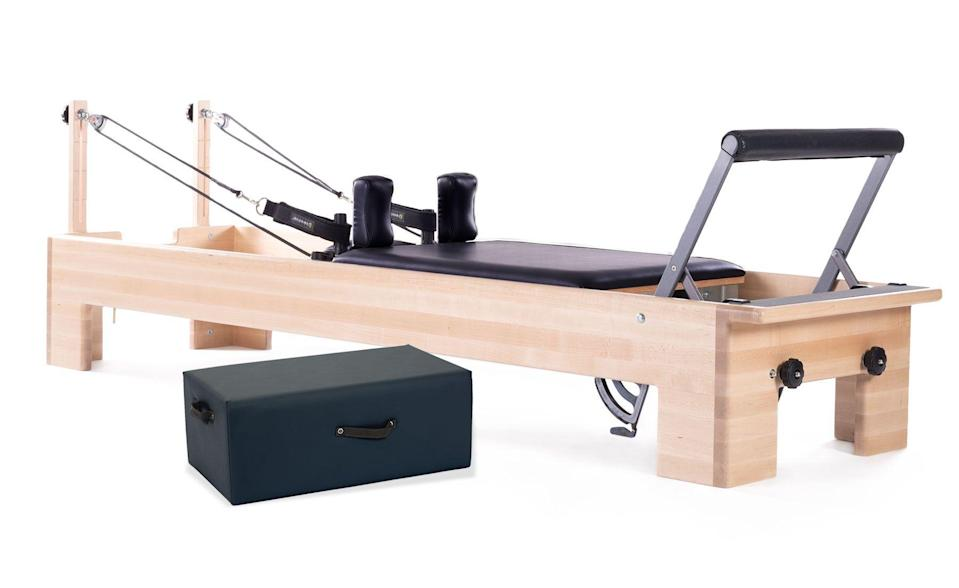 """<p>pilates.com</p><p><strong>$1.00</strong></p><p><a href=""""https://www.pilates.com/store/pilates-equipment/reformers/pilates-studio-reformer/"""" rel=""""nofollow noopener"""" target=""""_blank"""" data-ylk=""""slk:Shop Now"""" class=""""link rapid-noclick-resp"""">Shop Now</a></p><p>This sleek, wood-framed machine might blend into your mid-century modern aesthetic than other machines. It's an excellent choice for taller people, too, given the length of its carriage. </p><p><strong>Reviewer rave:</strong> """"This is the best investment that I've made in a while! There is definitely sticker shock when you hit the purchase button....but if you do the math, it makes sense! It is exactly the same reformer as at my local pilates studio, so it's easy to move forward with my practice."""" <em>—Lori Weatherly, amazon.com </em></p>"""