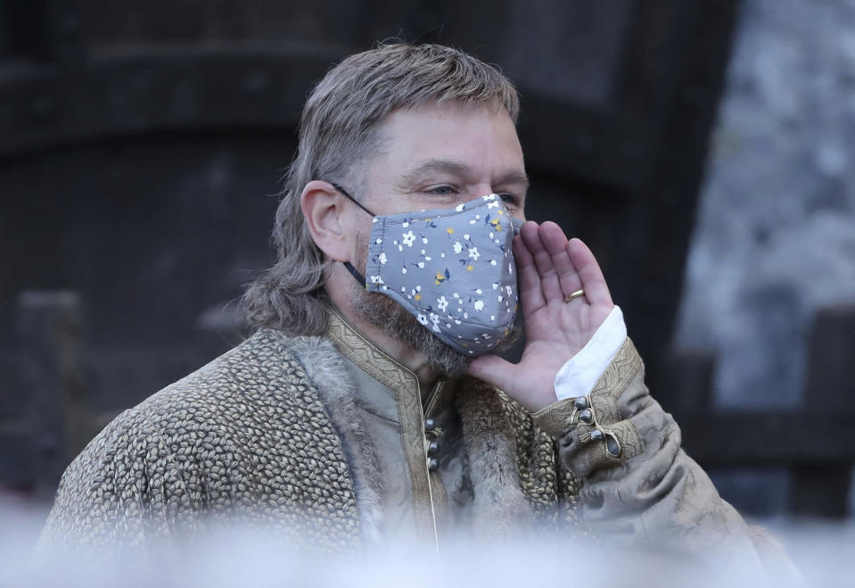 Actor Matt Damon, wearing a face mask to protect against coronavirus, leaves the set of the Last Duel, an historical drama-thriller film directed by Ridley Scott, at Cahir Castle in Cahir, County Tipperary, Ireland, Tuesday, Sept. 29, 2020. (Niall Carson/PA via AP)