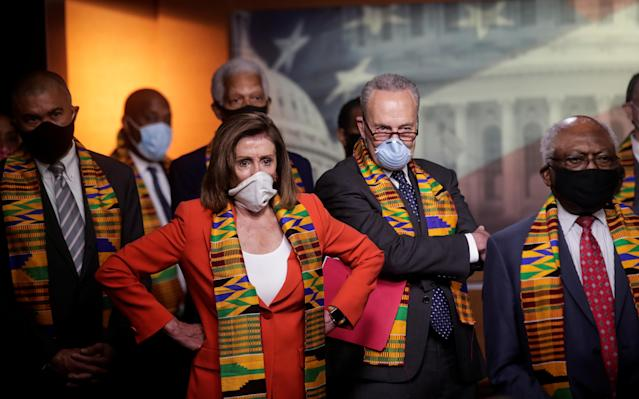 House Speaker Nancy Pelosi, Senate Minority Leader Chuck Schumer and other congressional Democrats during a news conference Monday. (Jonathan Ernst/Reuters)