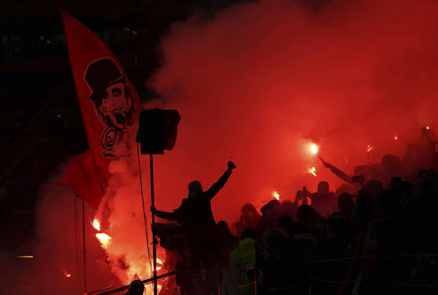 Lyon's fans use flares as they celebrate a goal during the French League One soccer match between Lyon and Nice at Groupama stadium in Decines, near Lyon, central France, Saturday, Nov. 23, 2019