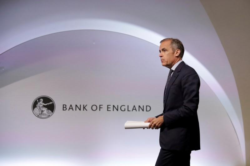FILE PHOTO: Mark Carney the Governor of the Bank of England attends a Financial Stability Report news conference at the Bank of England in the City of London