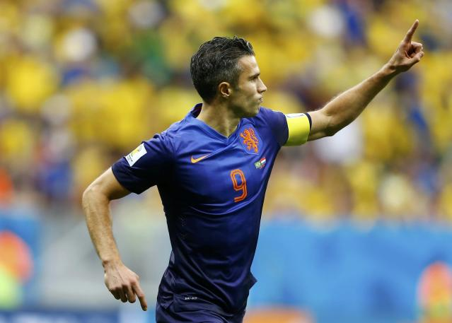 Robin van Persie of the Netherlands celebrates after scoring a goal from a penalty kick during their 2014 World Cup third-place playoff against Brazil at the Brasilia national stadium in Brasilia July 12, 2014. REUTERS/Dominic Ebenbichler (BRAZIL - Tags: SOCCER SPORT WORLD CUP TPX IMAGES OF THE DAY)