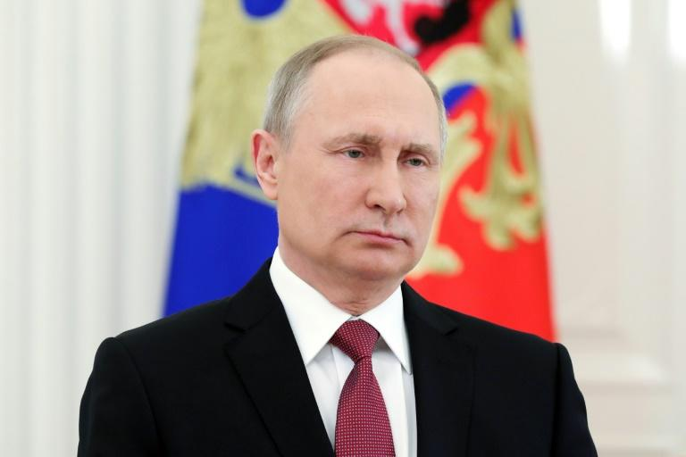 Russian President Vladimir Putin delivers a televised address to the nation in Moscow on March 23, 2018, following the announcement of the presidential election official results