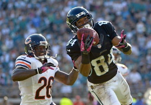 Jacksonville Jaguars wide receiver Cecil Shorts (84) catches a pass for a 34-yard gain in front of Chicago Bears cornerback Tim Jennings (26) during the first half of an NFL football game, Sunday, Oct. 7, 2012, in Jacksonville, Fla. (AP Photo/Phelan M. Ebenhack)