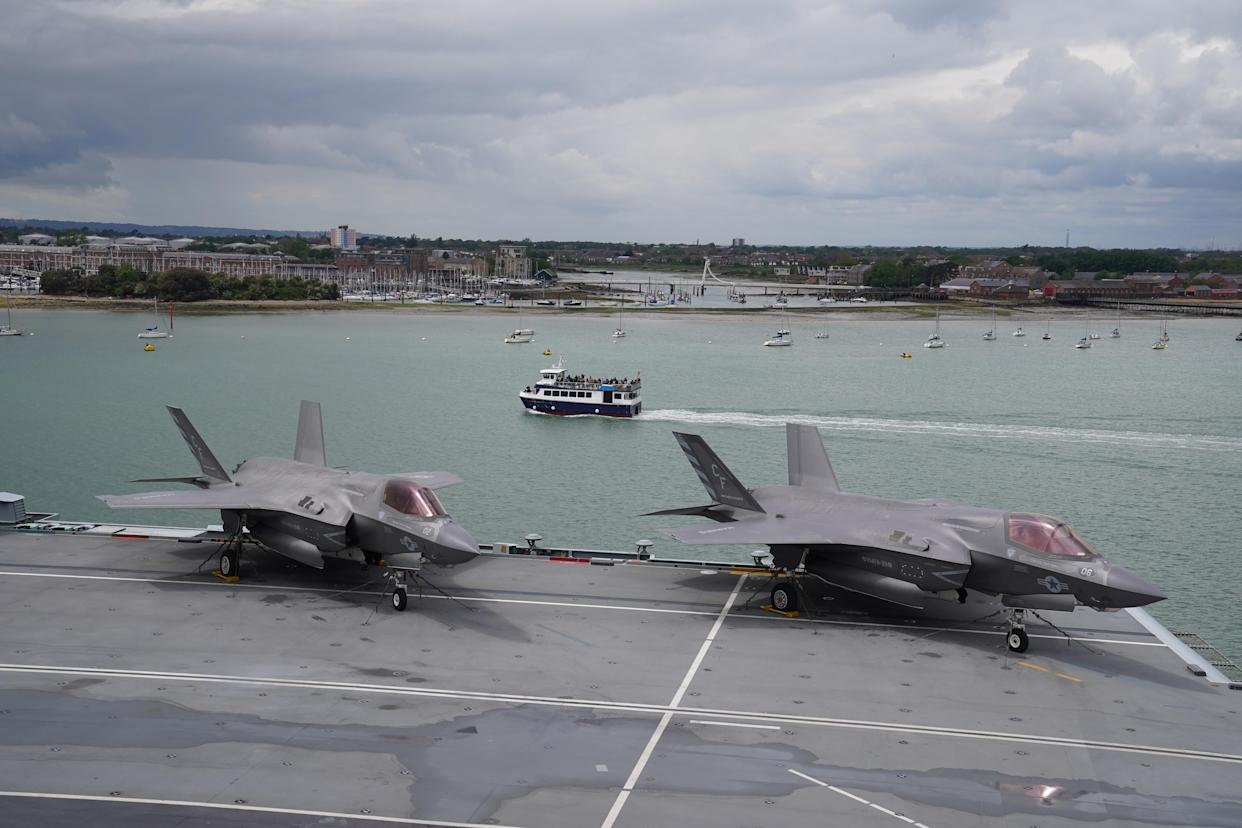 PORTSMOUTH, ENGLAND - MAY 22: A pair of F-35B Lightning II jets on the flight deck during Queen Elizabeth II's visit to HMS Queen Elizabeth at HM Naval Base ahead of the ship's maiden deployment on May 22, 2021 in Portsmouth, England. The visit comes as HMS Queen Elizabeth prepares to lead the UK Carrier Strike Group on a 28-week operational deployment travelling over 26,000 nautical miles from the Mediterranean to the Philippine Sea. (Photo by Steve Parsons - WPA Pool / Getty Images)