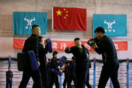 Trainees from Dewei Security attend boxing training at a training camp, on the outskirts of Beijing, China March 2, 2017. REUTERS/Jason Lee