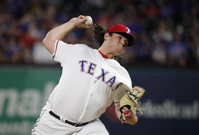 Texas Rangers' Ian Gibaut throws to the Oakland Athletics during the sixth inning of a baseball game in Arlington, Texas, Friday, Sept. 13, 2019. (AP Photo/Tony Gutierrez)