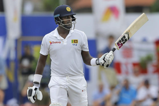 Sri Lanka's Angelo Mathews celebrates scoring a half century during the fourth day of the first test cricket match between Sri Lanka and England in Galle, Sri Lanka, Friday, Nov. 9, 2018. (AP Photo/Eranga Jayawardena)