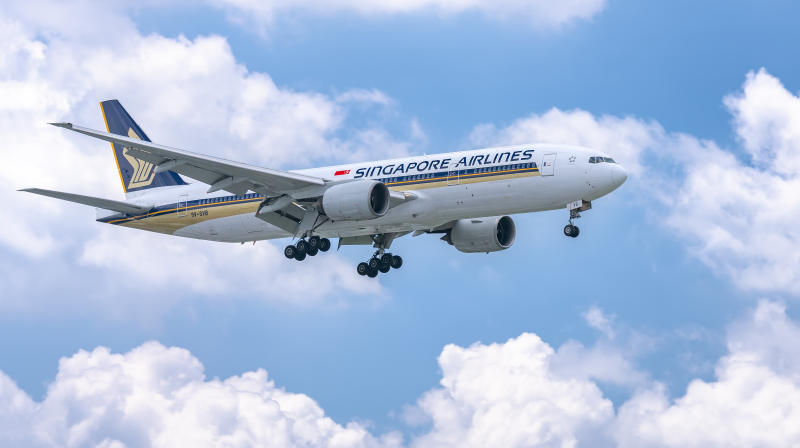 Ho Chi Minh City, Vietnam - June 8th, 2019: Airplane Boeing 777 of Singapore Airlines flying through clouds sky prepare to landing at Tan Son Nhat International Airport, Ho Chi Minh City, Vietnam