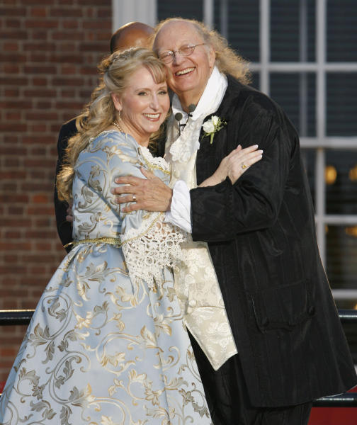 FILE – In this July 3, 2008, file photo, historical re-enactors Ralph Archbold, right, who portrays Benjamin Franklin, and Linda Wilde, left, who portrays Betsy Ross, smile to the crowd after exchanging wedding vows while dressed in Colonial-era formalwear, during their real-life wedding ceremony in front of Independence Hall in Philadelphia. Archbold, who portrayed Franklin in Philadelphia for more than 40 years, died Saturday, March 25, 2017, at age 75, according to the Alleva Funeral Home in Paoli, Pa. (AP Photo/Tom Mihalek, File)