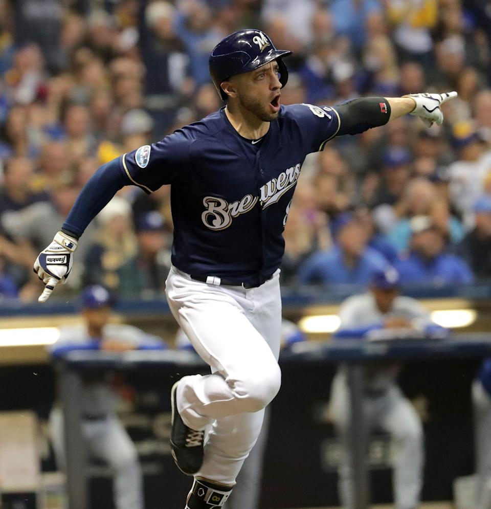 Milwaukee Brewers left fielder Ryan Braun (8) reacts to hitting a single that scored Santana in the fourth inning. The Brewers play the Los Angeles Dodgers in Game 1 of the National League Championship Series baseball game Friday, October 12, 2018 at Miller Park in Milwaukee, Wis. MARK HOFFMAN/MILWAUKEE JOURNAL SENTINEL ORG XMIT: MJS1810122056436010