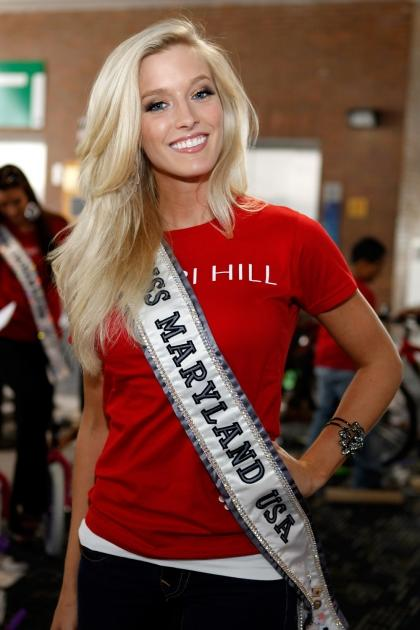 Miss Maryland Allyn Rose builds bikes for children of the troops at Pier 88, New York City, on May 26, 2011 -- Getty Images